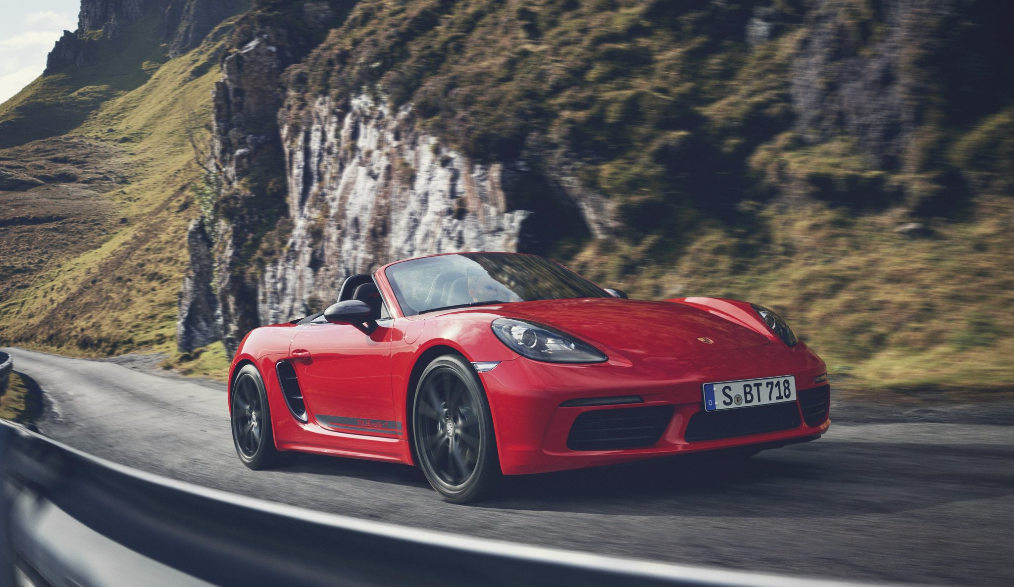 The New Two Seater Sports Car In Boxster And Cayman Ranges Combines Traditional Puristic Design 220 Kw 300 Ps Turbo Four Cylinder Flat Engine With A